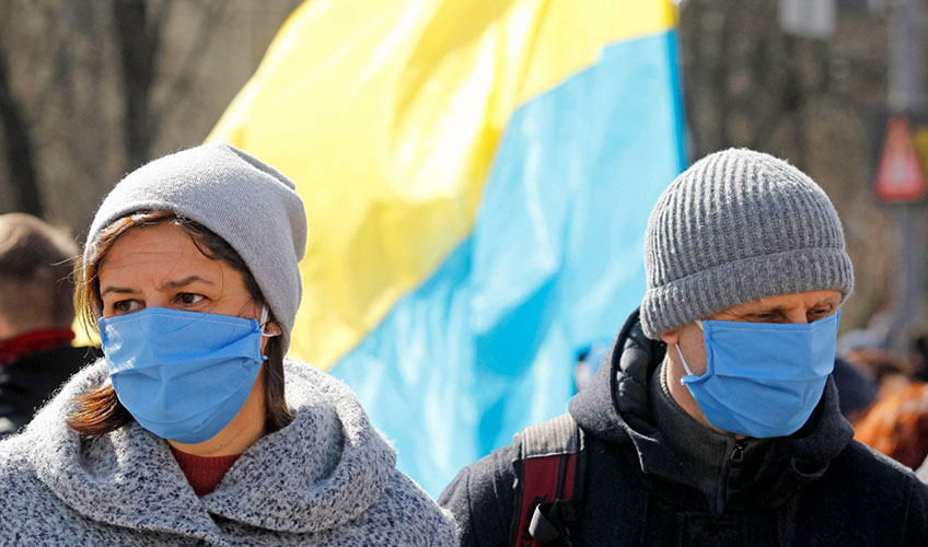People wearing protective masks as a preventive measure against COVID-19 during a march in Ukraine.