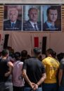A crowd of Syrian nationals living in Lebanon gather at the Syrian Embassy in Yarze, east of Beirut, waiting to cast their votes in the country's presidential election.