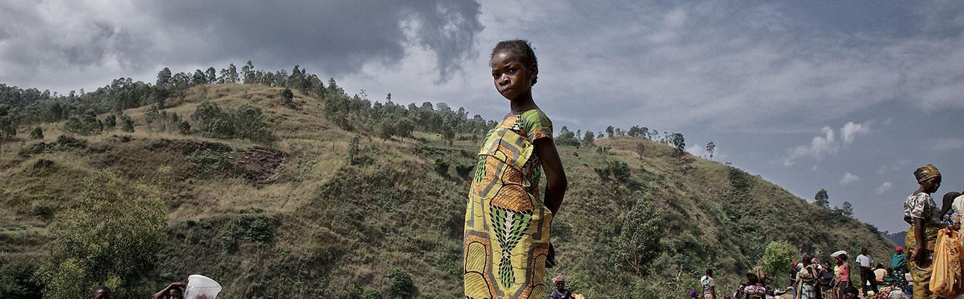 Young girl waits for mother to finish work at Rusizi Border, Bukavu photo by Carol Allen Storey