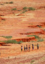 People walking through the landscape of the Sahel.