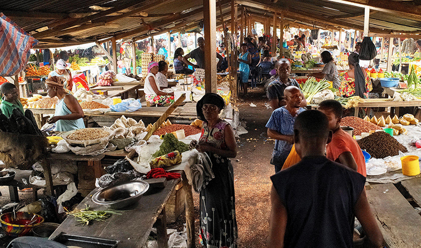 Small-scale traders selling their products at in a market in DRC.