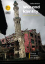 Front cover showing a burnt-out building.
